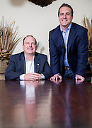 Sam Hollis, President &amp; Co-Founder of Milestone Construction, and Travis Ruff, Co-Founder, pose for a photo in a conference room at the company on Monday, May 19, 2014, in Springdale, Ark.<br /> Photo by Beth Hall