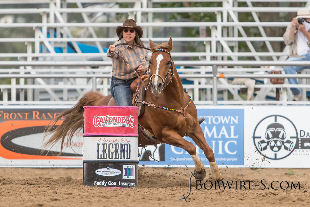 Debbie Beede makes her barrel racing run during slack at the Elizabeth Stampede on Sunday, June 3, 2018.