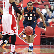Tracy Abrams #13 of the Illinois Fighting Illini on defense during the NIT First Round game at Agganis Arena on March 19, 2014 in Boston, Massachusetts . (Photo by Elan Kawesch)