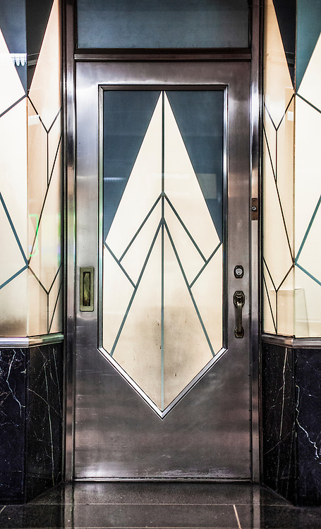 An Art Deco-style door and window treatment at a small office or shop in the Chrysler Building's  basement shopping  arcade.