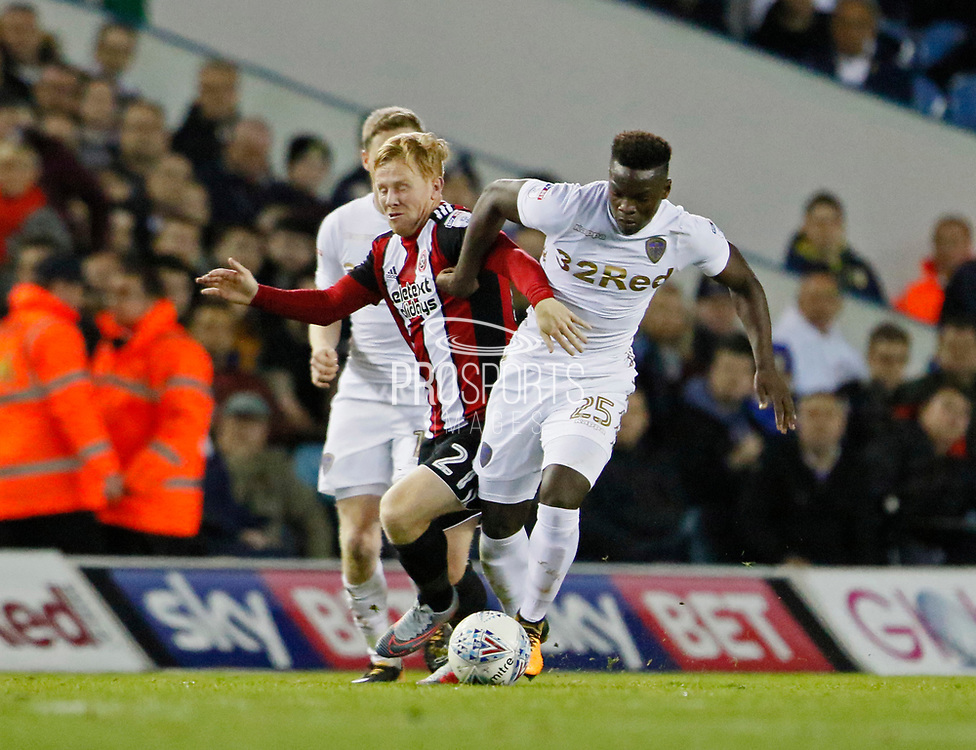 Sheffield United's Mark Duffy and Ronaldo Vieira of Leeds United contest a loose ball during the EFL Sky Bet Championship match between Leeds United and Sheffield Utd at Elland Road, Leeds, England on 27 October 2017. Photo by Paul Thompson.