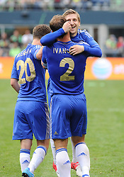 July 18, 2012: CenturyLink Field, Seattle, WA: Chelsea FC Branislav Ivanonic embraces Marko Marin after scoring a goal at the World Football Challenge. Chelsea FC defeated the Seattle Sounders 4-2.