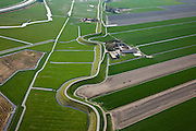 Nederland, Noord-Holland, Gemeente Schagen, 28-04-2010; Westfriese Dijk, onderdeel van de Westfriese Omringdijk, de vroegere zeewering, ten noorden van Schagen. De dijk gaat met bochten om vroegere wielen, restanten van vroegere dijkdoorbraken..Westfriese Dijk, part of the 'Westfrisian Surrounding Dike'. The dike curves around old breaches of the seawall. .luchtfoto (toeslag), aerial photo (additional fee required).foto/photo Siebe Swart