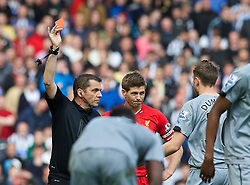 LIVERPOOL, ENGLAND - Sunday, May 11, 2014: Newcastle United's Paul Dummett is shown a red card and sent off by referee Phil Dowd during the Premiership match against Liverpool at Anfield. (Pic by David Rawcliffe/Propaganda)