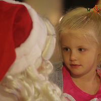 Santa Clause talks to Leigha Midgette, 5, during the Greenfield Christmas Tree lighting at Greenfield Lake Park Thursday December 4, 2014 in Wilmington, N.C. (Jason A. Frizzelle)