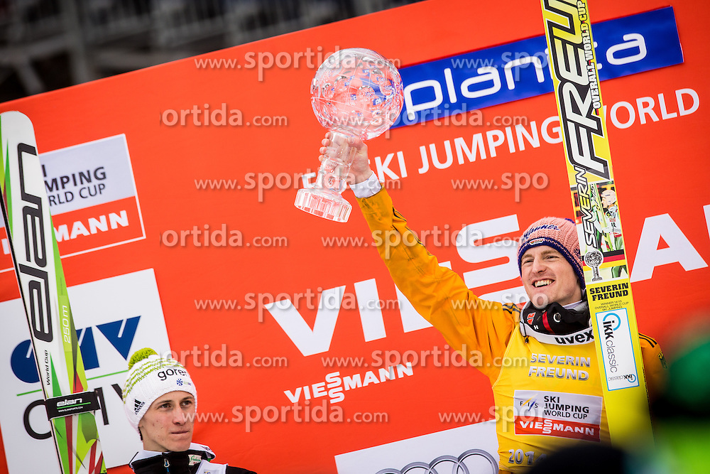 Overall World Cup winner Severin Freund of Germany celebrates with a globe and Peter Prevc of Slovenia during final trophy ceremony after the Ski Flying Individual Competition at Day 4 of FIS World Cup Ski Jumping Final, on March 22, 2015 in Planica, Slovenia. Photo by Grega Valancic / Sportida