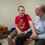ROCKVILLE, MD - JUL25: John Bucknam, 18, who has autism, listens to music on his dad Mark's iPhone in his bedroom, July 25, 2014, in Rockville, MD. The Bucknam's have a series of locks on their doors to keep John from wandering off. (Photo by Evelyn Hockstein/For The Washington Post)