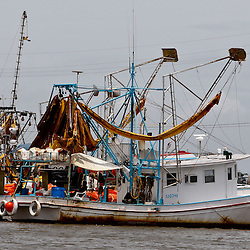 A Shrimp boat skimmer with oil stained boom is seen docked as vessels seek safe harbor due to heavy seas caused by Hurricane Alex in Port Fourchon, Louisiana, U.S., on Wednesday, June 30, 2010. The BP Plc oil spill, which began when the leased Transocean Deepwater Horizon oil rig exploded on April 20, is gushing as much as 60,000 barrels of oil a day into the Gulf of Mexico, the government said. Photographer: Derick E. Hingle/Bloomberg