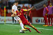 Warsaw, Poland - 2017 October 08: (L) Robert Lewandowski of Poland fights for the ball with (R) Nikola Vukcevic of Montenegro during soccer match Poland v Montenegro - FIFA 2018 World Cup Qualifier at PGE National Stadium on October 08, 2017 in Warsaw, Poland.<br /> <br /> Mandatory credit:<br /> Photo by © Adam Nurkiewicz / Mediasport<br /> <br /> Adam Nurkiewicz declares that he has no rights to the image of people at the photographs of his authorship.<br /> <br /> Picture also available in RAW (NEF) or TIFF format on special request.<br /> <br /> Any editorial, commercial or promotional use requires written permission from the author of image.