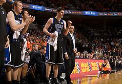Duke center Brian Zoubek (55) and Duke head coach Mike Krzyzewski on the bench against UVA.  The Virginia Cavaliers men's basketball team fell to the #6 Duke Blue Devils 86-70 at the University of Virginia's John Paul Jones Arena in Charlottesville, VA on March 5, 2008.