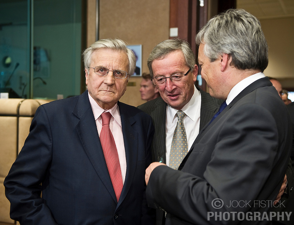 Jean-Claude Trichet, president of the European Central Bank, left,  speaks with Jean-Claude Juncker, Luxembourg's prime minister, and president of the Eurogroup, center, and Didier Reynders, Belgium's finance minister, right, during the Eurogroup meeting in Brussels on Monday May 17, 2010. (Photo © Jock Fistick)