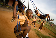 Girls playing on a swing at the Dahin-Sheli primary school in Tamale, northern Ghana, on Friday June 8, 2007.