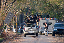 08 Sept 2005. New Orleans, Louisiana.  Hurricane Katrina aftermath.<br /> The FBI arrive heavily armed to deal with reports of armed residents holed up in a school in Uptown New Orleans. The authorities demand the evacuation of every last resident of the city.<br /> Photo; ©Charlie Varley/varleypix.com