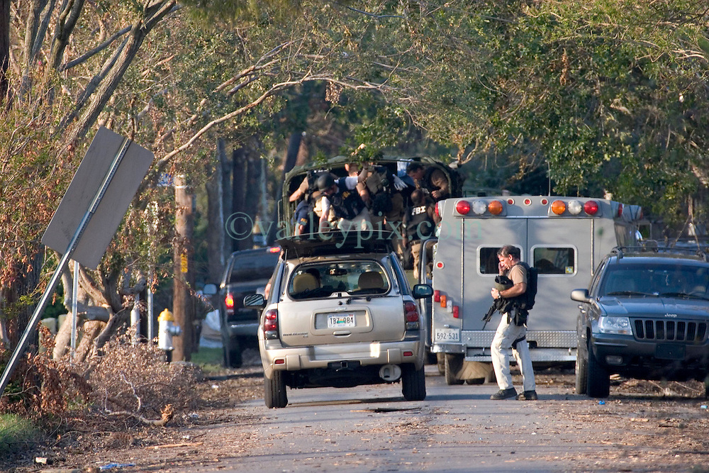 08 Sept 2005. New Orleans, Louisiana.  Hurricane Katrina aftermath.<br /> The FBI arrive heavily armed to deal with reports of armed residents holed up in a school in Uptown New Orleans. The authorities demand the evacuation of every last resident of the city.<br /> Photo; &copy;Charlie Varley/varleypix.com