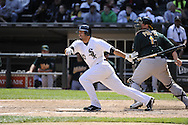 CHICAGO - JUNE 12:  Carlos Quentin #20 of the Chicago White Sox bats against the Oakland Athletics on June 12, 2011 at U.S. Cellular Field in Chicago, Illinois.  The White Sox defeated the Athletics 5-4.  (Photo by Ron Vesely)   Subject:  Carlos Quentin
