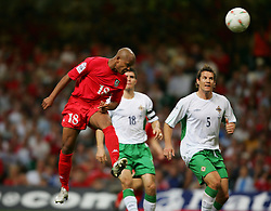 CARDIFF, WALES - Wednesday, September 8, 2004: Wales' Robert Earnshaw scores the equalising goal against Northern Ireland with a header during the Group Six World Cup Qualifier at the Millennium Stadium. (Pic by David Rawcliffe/Propaganda)