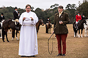 A lay minister provides the Blessing of the Hounds to mark the start of the Fox Hunting season at Middleton Place Plantation December 1, 2013 in Charleston, SC.