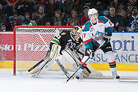 KELOWNA, CANADA - JANUARY 26: Ryan Olsen #27  of the Kelowna Rockets looks for the pass in front of Andy Desautels #33 of the Prince Albert Raiders as he defends the net at the Kelowna Rockets on January 26, 2013 at Prospera Place in Kelowna, British Columbia, Canada (Photo by Marissa Baecker/Shoot the Breeze) *** Local Caption ***