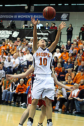 20 March 2010: Jenny Cowen grabs a rebound but loses the handle as she is attacked from behind. The Flying Dutch of Hope College fall to the Bears of Washington University 65-59 in the Championship Game of the Division 3 Women's NCAA Basketball Championship the at the Shirk Center at Illinois Wesleyan in Bloomington Illinois.