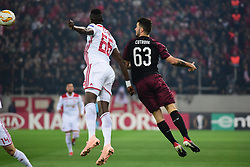 December 13, 2018 - Piraeus, Attiki, Greece - Pape Abou Cisse (no 66) of Olympiacos and Patrick Cutrone (no 63) of Milan, vies for the ball. (Credit Image: © Dimitrios Karvountzis/Pacific Press via ZUMA Wire)