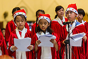 The children choir sings carols during Christmas services at Holy Redeemer Church in Bangkok. Thailand is predominantly Buddhist but Christmas is widely celebrated throughout the country. Buddhists mark the day with secular gift giving but there are about 300,000 Catholics in Thailand who celebrate religious Christmas. Catholics first came to Thailand (then Siam) in 1567 as chaplain for Portuguese mercenaries in the employ of the Siamese monarchy. There has been a continuous Catholic presence in Thailand since then.