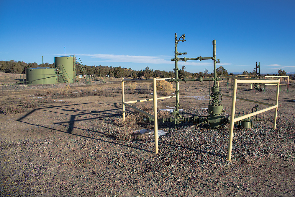 Gas industry site in the San Juan Basin on BLM land with a warning sign on the Shcreiber's ranch.