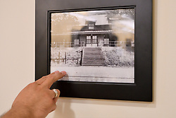Mayor Peter Ursucheler points to a picture of the former train station in Phoenixville, PA, on august 21, 2018. The Colombia Station currently houses an event venue.