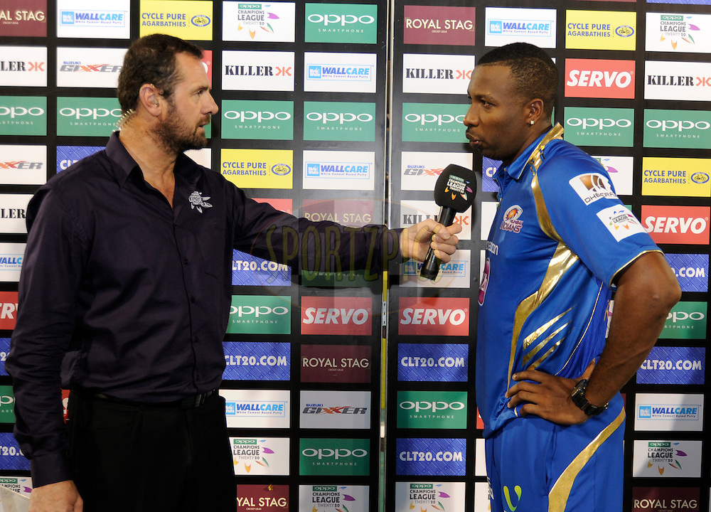 Kieron Pollard captain of Mumbai Indians during the presentation after the qualifier 4 match of the Oppo Champions League Twenty20 between the Mumbai Indians and the Southern Express held at the Chhattisgarh International Cricket Stadium, Raipur, India on the 14th September 2014<br /> <br /> Photo by:  Pal Pillai / Sportzpics/ CLT20<br /> <br /> <br /> Image use is subject to the terms and conditions as laid out by the BCCI/ CLT20.  The terms and conditions can be downloaded here:<br /> <br /> http://sportzpics.photoshelter.com/gallery/CLT20-Image-Terms-and-Conditions-2014/G0000IfNJn535VPU/C0000QhhKadWcjYs