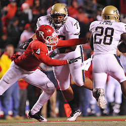 Oct 16, 2009; Piscataway, NJ, USA; Rutgers cornerback David Rowe (4) reaches in vain for Pittsburgh running back Dion Lewis (28) during first half NCAA football action in Pittsburgh's 24-17 victory over Rutgers at Rutgers Stadium.