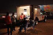 The night ambulance at its first stop by the main road in Tshangu district. .The ambulance provides both emergency healthcare and also acts as an outreach service - offering guidance and support from women from similar backgrounds who have managed to escape life on the streets. Tshangu district is one of the least safe areas of Kinshasa. It's close to the airport and an army base - and therefore it acts as a magnet for the sex trade...War Child. Kinshasa. DRC...© Zute and Demelza Lightfoot. 0027 (0) 715957313.www.lightfootphoto.com