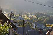 An early morning landscape of a rural Slovenian valley village community and nearby hills, on 19th June 2018, in Bohinjska Bela, Bled, Slovenia.