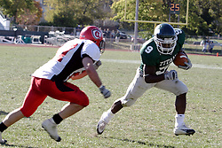07 October 2006: Marcus Dunlop cuts to avoid Red Man defender Dave Linn. The Titans of Illinois Wesleyan University started off strong with a touchdown on the 2nd play from scrimmage in the game.  The Titans led most of the way, but failed to maintain the lead in the 4th quarter giving up the decision of this CCIW conference game to the Red Men of Carthage by a score of 31 - 28. Action was at Wilder Field on the campus of Illinois Wesleyan University in Bloomington Illinois.<br />