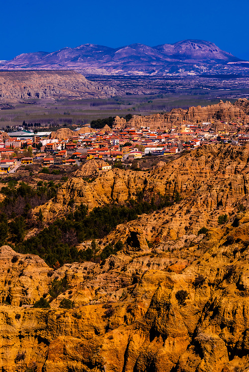 View of Badlands from Mirador del Fin del Mundo looking to the town of Purullena, near Guadix, Granada Province, Andalusia, Spain.