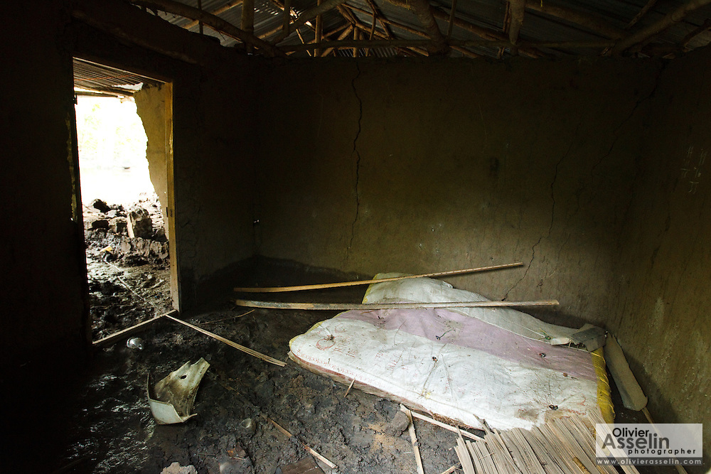 A mattress lies on the floor in a house that was badly damaged by floods in the village of Kotacomey, Benin on Monday October 25, 2010.