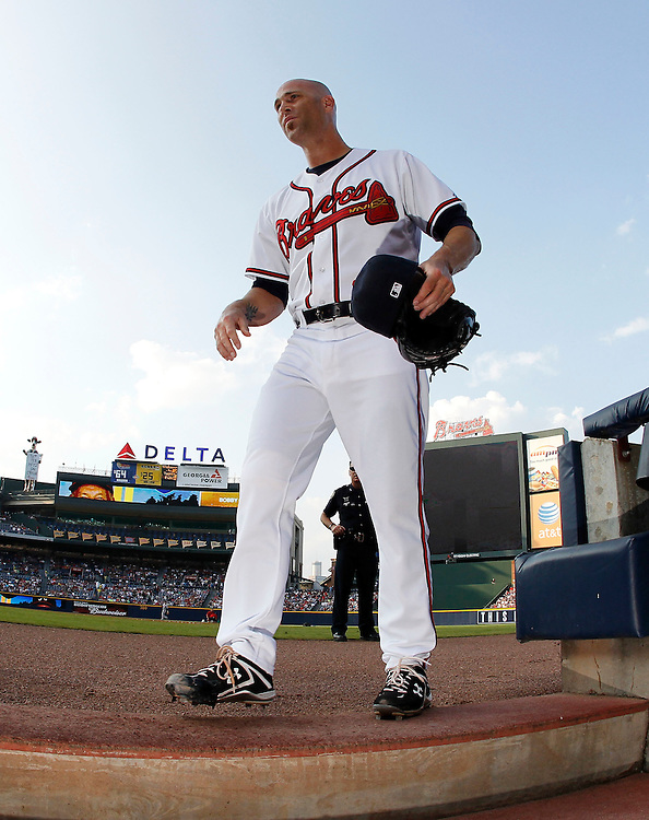 ATLANTA - AUGUST 7:  Pitcher Tim Hudson #15 of the Atlanta Braves comes in the dugout before the game against the San Francisco Giants at Turner Field on August 7, 2010 in Atlanta, Georgia.  The Braves beat the Giants 3-0.  (Photo by Mike Zarrilli/Getty Images)