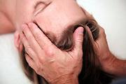 woman receiving scalp massage during Swedish massage