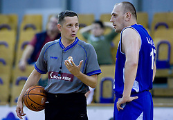 Referee Sasa Pukl and Aleksej Laskevic of Helios at third finals basketball match of Slovenian Men UPC League between KK Union Olimpija and KK Helios Domzale, on June 2, 2009, in Arena Tivoli, Ljubljana, Slovenia. Union Olimpija won 69:58 and became Slovenian National Champion for the season 2008/2009. (Photo by Vid Ponikvar / Sportida)