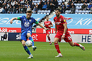 Wigan Athletic midfielder Joe Williams (20)clears the danger from Nottingham Forest forward Rafa Mir (14) during the EFL Sky Bet Championship match between Wigan Athletic and Nottingham Forest at the DW Stadium, Wigan, England on 20 October 2019.