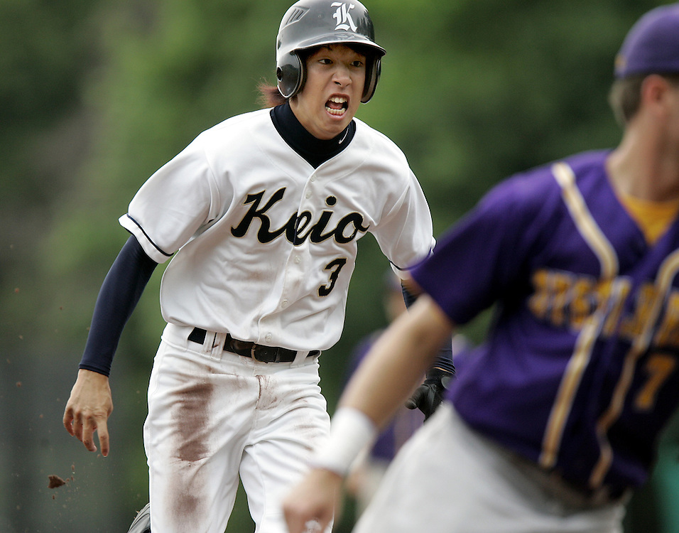 Mamaroneck, NY / 2009 - Keio's Yoshi Imaeda, right, rounds second base  and heads to third as Oyster Bay's Joe Carbone, right, tries to get out of the way during the boys varsity baseball Class C regional final game between Keio Academy and Oyster Bay at Rye Neck High School. Oyster Bay won the game 3-1. ( Mike Roy / The Journal News )
