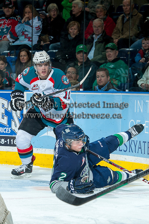 KELOWNA, CANADA -FEBRUARY 10: Carter Rigby #11 of the Kelowna Rockets checks Jerret Smith #2 of the Seattle Thunderbirds to the ice during first period on February 10, 2014 at Prospera Place in Kelowna, British Columbia, Canada.   (Photo by Marissa Baecker/Getty Images)  *** Local Caption *** Carter Rigby; Jerret Smith;