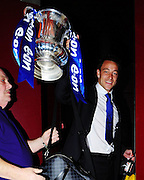 30.MAY.2009 - LONDON<br /> <br /> JOHN TERRY ARRIVING AT FRANKIES BAR &amp; GRILL, KNIGHTSBRIDGE FOR DINNER AND DRINKS TO CELEBRATE CHELSEA'S 2-1 WIN IN THE FA CUP FINAL OVER EVERTON, AS THE COACH PULLED UP AT THE RESTAURANT THE FA CUP WAS ON THE FRONT WINDOW UNTILL JOHN PICKED UP THE FA CUP ASWELL AS HOLDING A BOTTLE OF BEER. HE THEN WENT OUTSIDE HOLDING THE CUP AND POSED WITH FANS AND IN THE PLASTIC BAG HE HAD HIS KIT IN IT FROM THE MATCH AND JOHN HAD A KIT BAG WITH A PICTURE OF HIM AND HIS SON ON THE FRONT OF IT. <br /> <br /> BYLINE MUST READ : EDBIMAGEARCHIVE.COM<br /> <br /> *THIS IMAGE IS STRICTLY FOR UK NEWSPAPERS &amp; MAGAZINES ONLY* <br /> *FOR WORLDWIDE SALES OR WEB USE PLEASE CONTACT EDBIMAGEARCHIVE - 0208 954 5968*