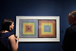 "© Licensed to London News Pictures. 03/05/2017. London, UK. Visitors view ""Double Gray Scramble"", 1973, by Frank Stella at the preview of the 32nd London Original Print Fair at the Royal Academy of Arts in Piccadilly.  51 international specialist dealers are presenting works in the print medium to buyers from 4 May to 7 May. Photo credit : Stephen Chung/LNP"