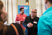 Dan Krivicich of Electronic Vision chats with visitors during the CCN Expo in Walter Hall Rotunda on Wednesday, May 13, 2015.  Photo by Ohio University  /  Rob Hardin