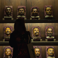 "VENICE, ITALY - MARCH 09:  A woman look at 12 portraits of criminals modelled in the late 19th century by Lorenzo Tenchini, a pupil of Cesare Lombroso are seen at the press preview of ""Avere Una Bella Cera - Wax Portraits Exhibition"" at Palazzo Fortuny on March 9, 2012 in Venice, Italy.  The exhibition open until June 25 is the world's first exhibition on wax portraits analizing a field that has been studied very little by art historians."