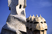 White mosaic spiral and faces of sculpted chimney heads of Casa Milà, or La Pedrera, Antoni Gaudi architecture, Barcelona, Spain