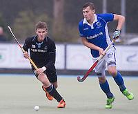 UTRECHT- Hockey -  Philip Meulenbroek (r) van Kampong met Goof van der Kamp van HGC  tijdens de hoofdklasse competitiewedstrijd tussen de mannen van Kampong en HGC (2-1). COPYRIGHT KOEN SUYK
