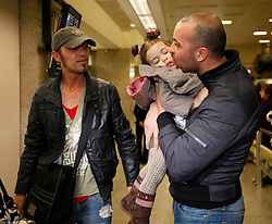 A man (R) arriving from Tripoli on an evacuation flight kisses his daughter at Malta International Airport outside Valletta February 23, 2011. .Photo by Darrin Zammit Lupi