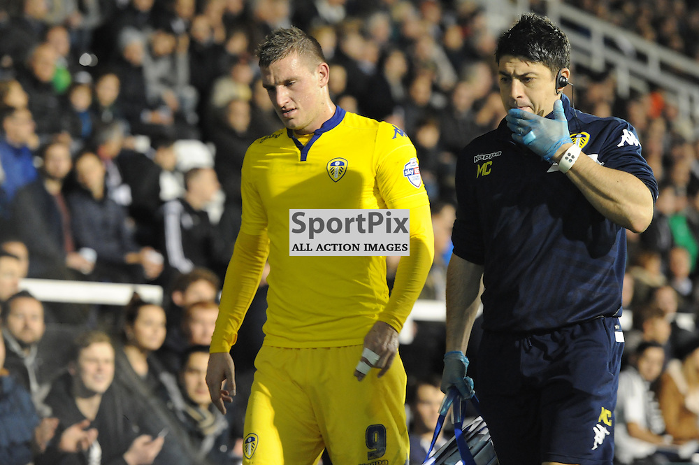 Leeds goal scorer Chris Wood leaves the pitch after an injury during Fulham v Leeds United game in the Sky Bet Championship at Craven Cottage on the 21st October 2015.
