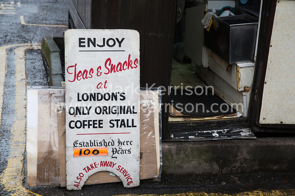 London, UK. 20 December, 2019. A sign outside Syd's Coffee Stall, which has been run by three generations of the same family on the corner of Shoreditch High Street and Calvert Avenue since 1919, shortly before its very last customer was served. The mahogany coffee stall will go on display in the new Museum of London in Smithfield in 2024.