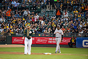 San Francisco Giants fans celebrate a run against the Oakland Athletics at Oakland Coliseum in Oakland, California, on July 31, 2017. (Stan Olszewski/Special to S.F. Examiner)